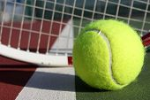 Tennis ball and racket