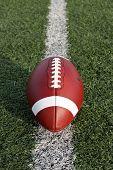 stock photo of football field  - American Football on the yard line vertical - JPG