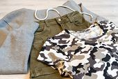 Teen Clothing Set: Grey Sweatshirt, Green Shorts And T-short In Military Style poster