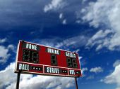 Baseball scoreboard with blue sky and clouds