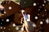 love, romance and people concept - close up of happy couple in winter clothes poster
