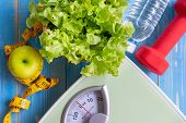 Diet And Healthy Life Concept. Green Apple And Weight Scale Measure Tap With Fresh Vegetable, Clean  poster
