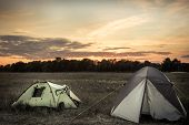 Camping Tents On Camping Sites On Summer Flatland Field Plain And Dramatic Sunset Sky During Camping poster