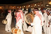 A qatari folk troupe performing at the Heritage Village on Doha Corniche during the Doha Cultural Fe