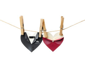 stock photo of heart shape  - Symbolic male and female heart shapes hanging on the clothesline - JPG