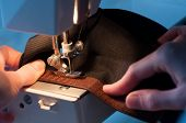 Seamstress Sewing On Velcro Hook-and-loop Fastener