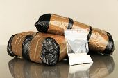 stock photo of smuggling  - Packages of  narcotics on gray background - JPG