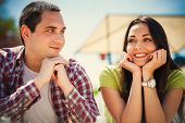 young couple on first date, outdoor shot summer day