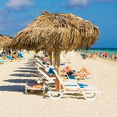 VARADERO,CUBA-MAY 19:Vacationers sunbathing at the beach May 19,2013 in Varadero.With the growing fl