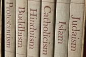 stock photo of spine  - Book spines listing major world religions  - JPG