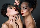 Dainty. Two Provocative Women In Veils With Cherry Berries. Temptation