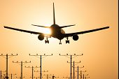 stock photo of lax  - Airplane landing at Los Angeles International Airport during sunset Los Angeles California USA - JPG