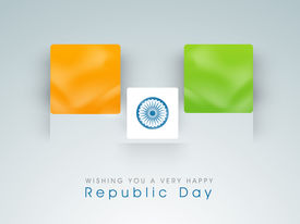 stock photo of asoka  - Happy Indian Republic Day concept with national flag colors board with Asoka wheel on grey background - JPG