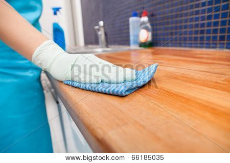 Woman Cleaning Kitchen Countertop poster