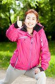 stock photo of mongolian  - Mongolian woman listening to music and training - JPG