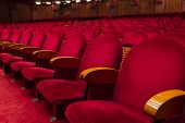 pic of cinema auditorium  - Empty red seats for cinema theater conference or concert