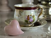 stock photo of pompous  - tea cup on the table ceramic heart - JPG