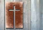 picture of religious  - Vintage old grungy paper banner with a Christian religious cross over ancient wood background - JPG