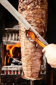 pic of shawarma  - Shawarma meat being cut before making a sandwich - JPG