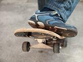 foto of skate board  - boy moves up on a skate board - JPG