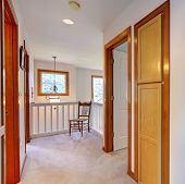 image of upstairs  - Upstairs hallway with deck and chair by the railings - JPG