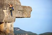 picture of rocking  - Young female rock climber a face of a cliff - JPG