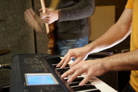 picture of recording studio  - keyboard player playing in studio - JPG