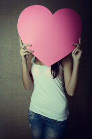 picture of incognito  - portrait of young woman holding pink heart incognito - JPG