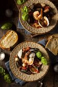 foto of clam  - Homemade Italian Seafood Cioppino with Mussels Clams and Shrimps - JPG