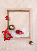 foto of glass-wool  - frame decorated with Christmas toys on beige wool fabric background - JPG