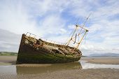 stock photo of bute  - A derelict fishing boat lit by evening sunshine at Ettrick Bay - JPG