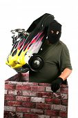 picture of shoplifting  - A genuine Bad Guy aka Burglar pops his head out of a chimney looking to see if the coast is clear for his escape after robbing money and valuables from a persons home - JPG