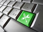 picture of tool  - Computer repair service concept with work tools icons and symbol on a green laptop computer key for website and online business - JPG
