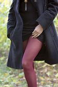 image of tight dress  - Girl in black coat and black dress with jewelry and red tights in autumn - JPG