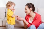 pic of babysitter  - View of baby eating snacks with mother - JPG