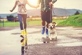 pic of wet feet  - Young couple walk dog in rain - JPG