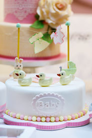stock photo of christening  - Baby birthday cake as gift for birth or christening party - JPG