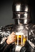 foto of knights  - knight wearing armor and holding mug of beer - JPG