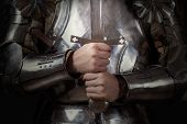 picture of longsword  - knight wearing armor and holding two - JPG