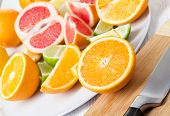 picture of plating  - Pieces of citrus fruits on white plate - JPG