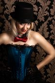 foto of cabaret  - beautiful cabaret woman posing on a chair - JPG
