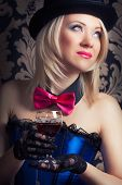 pic of cabaret  - beautiful cabaret woman holding a glass of red wine against retro wallpapers - JPG