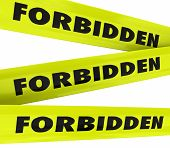 image of restriction  - Forbidden word on yellow tape to illustrate restricted access not allowed such as crime area or secured - JPG