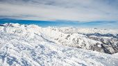 stock photo of torino  - Panoramic view of high mountain peaks in the italian alpine arc in a bright sunny day - JPG