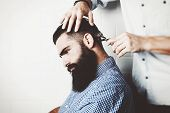 picture of barber  - Portrait of a brutal bearded guy in barber shop - JPG
