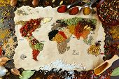foto of kindness  - Map of world made from different kinds of spices on wooden background - JPG