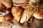 picture of sackcloth  - Different bread with ears on sackcloth background - JPG