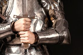 foto of sword  - knight wearing armor and holding two - JPG