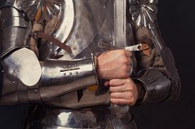 image of longsword  - knight wearing armor and holding two - JPG