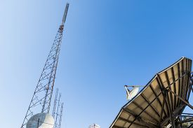 stock photo of antenna  - communication tower with analog television antenna transmitters - JPG